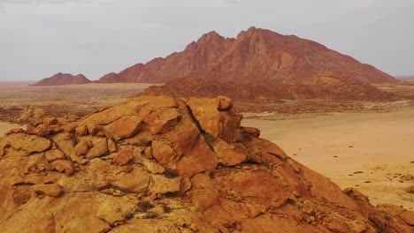 Aerial-over-the-Namib-Desert-and-the-massive-rock-formations-at-Spitzkoppe-Namibia-4