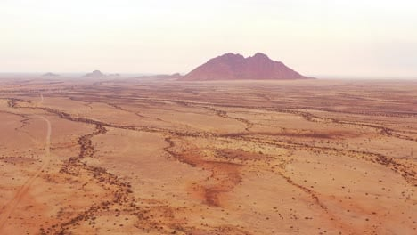 Aerial-over-the-Namib-Desert-and-the-massive-rock-formations-at-Spitzkoppe-Namibia-6