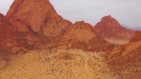 Aerial-over-the-Namib-Desert-and-the-massive-rock-formations-at-Spitzkoppe-Namibia-7