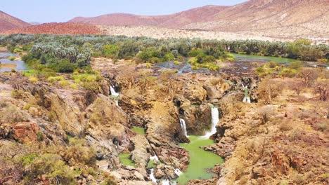 Una-Hermosa-Antena-Sobre-Epupa-Falls-En-La-Frontera-De-Angola-Y-Namibia-Africa-2