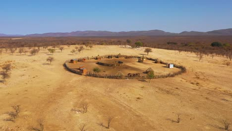 Beautiful-aerial-over-a-round-Himba-African-tribal-settlement-and-family-compound-in-northern-Namibia-Africa
