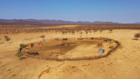 Beautiful-aerial-over-a-round-Himba-African-tribal-settlement-and-family-compound-in-northern-Namibia-Africa-1