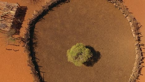 Rising-vista-aérea-over-a-Himba-African-tribal-settlement-and-family-compound-in-northern-Namibia-Africa