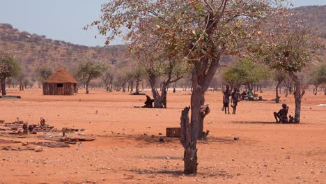 Small-poor-African-Himba-village-on-the-Namibia-Angola-border-with-mud-huts-and-children