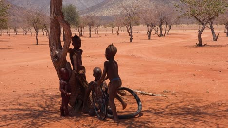 Poor-African-children-play-with-a-bicycle-wheel-as-a-toy-in-a-Himba-village-on-the-Namibia-Angola-border-1
