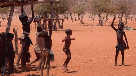 Poor-African-children-play-games-and-sports-with-a-ball-in-a-Himba-village-on-the-Namibia-Angola-border