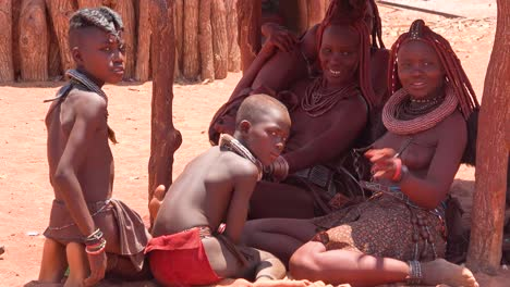 Beautiful-Himba-tribal-women-sit-in-the-shade-in-a-village-on-the-Namibia-Angola-border