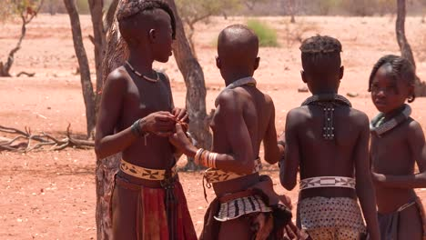 Poor-African-niños-play-games-and-sports-with-a-ball-in-a-Himba-village-on-the-Namibia-Angola-border-1
