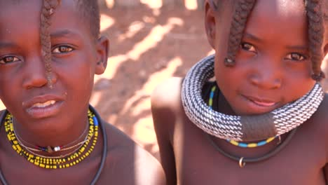 Beautiful-poor-African-children-Himba-tribes-portrait-look-into-the-camera-in-Namibia-or-Angola