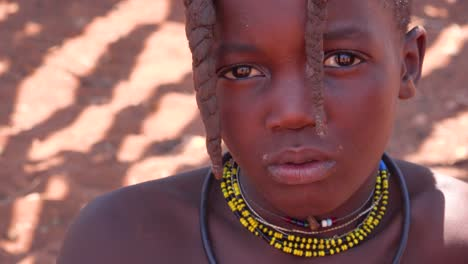 Beautiful-poor-African-children-Himba-tribes-portrait-look-into-the-camera-in-Namibia-or-Angola-1