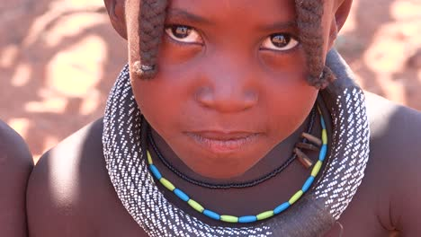 Beautiful-poor-African-children-Himba-tribes-portrait-look-into-the-camera-in-Namibia-or-Angola-2