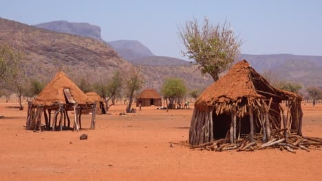 Small-poor-African-Himba-rural-village-on-the-Namibia-Angola-border-with-mud-huts-goats-and-children-1