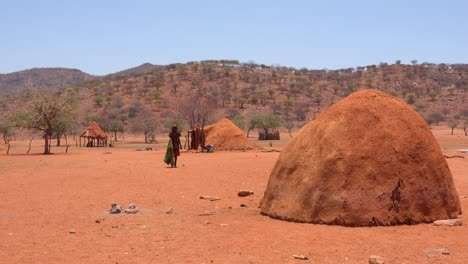 Small-poor-African-Himba-rural-village-on-the-Namibia-Angola-border-with-mud-huts-goats-and-children-2