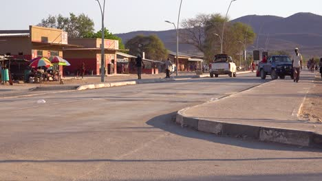 Opuwo-Namibia-village-street-and-traffic-with-shops-and-pedestrians