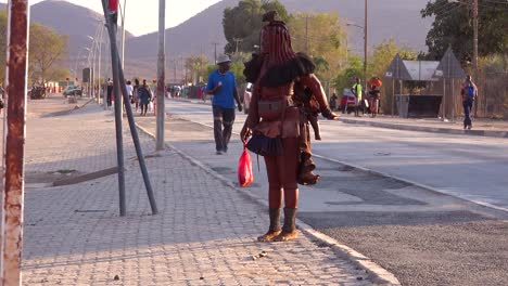 Himba-tribal-women-walk-on-the-streets-of-a-market-town-in-Africa-Opuwo-Namibia