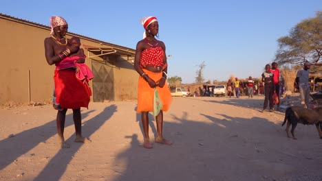 Two-African-tribal-women-pose-in-a-marketplace-in-the-market-town-of-Opuwo-Namibia