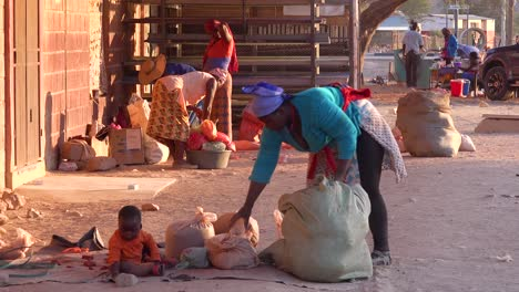 Poor-African-citizens-shop-in-a-basic-Africa-street-market-in-Opuwo-Namibia-1