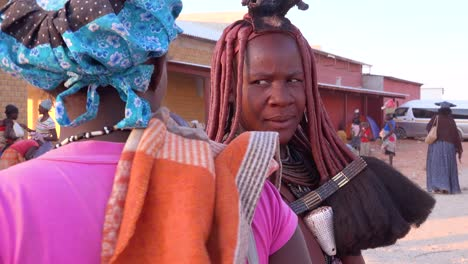 A-Himba-tribal-woman-shows-off-her-braided-mud-caked-dreadlock-hair-style-in-a-market-in-Opuwo-Namibia
