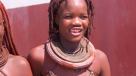 Beautiful-Himba-African-tribal-women-hold-their-babies-and-pose-with-mud-hair-style-and-dreadlocks-and-round-necklaces-1