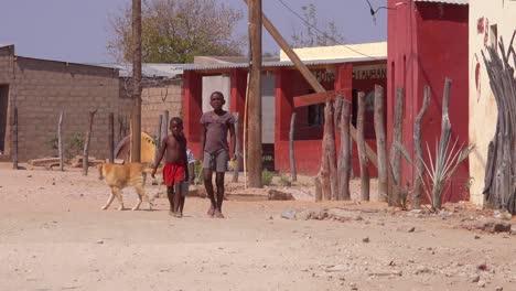 Small-children-walk-through-an-African-village-in-Damaraland-Namibia-Africa