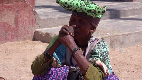 A-Herero-tribal-woman-with-dress-and-hat-in-a-marketplace-in-northern-Namibia-Africa