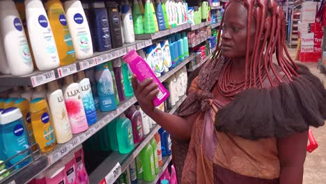 Astonishing-shot-of-tribal-African-Himba-woman-shopping-in-a-modern-supermarket-in-Opuwa-Namibia-contrast-of-old-and-modern-life-1