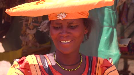 Beautiful-shot-of-Herero-African-tribal-woman-in-bright-fashion-costumes-at-a-marketplace-in-Namibia-Africa
