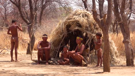 African-San-tribal-bushmen-family-at-their-huts-in-a-small-primitive-village-in-Namibia-Africa
