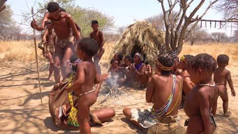 African-San-tribal-bushmen-perform-a-fire-dance-in-a-small-primitive-village-in-Namibia-Africa
