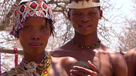 Beautiful-African-San-tribesmen-bushmen-family-portrait-with-baby-mother-and-father-parenthood