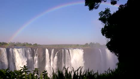 Beautiful-establishing-shot-with-rainbow-above-of-Victoria-Falls-from-the-Zimbabwe-side-of-the-African-waterfall-1