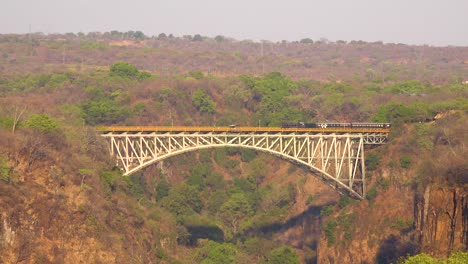 A-steam-passenger-train-crosses-a-bridge-near-Victoria-Falls-Zimbawbwe-or-Zambia-Africa-1