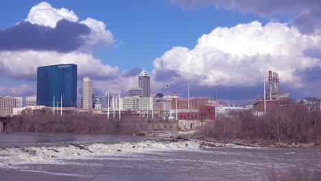 Beautiful-establishing-shot-of-Indianapolis-Indiana-with-big-storm-clouds-and-the-White-River-foreground-1