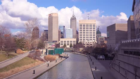 Establishing-shot-of-downtown-city-skyline-and-riverfront-walk-Indianapolis-Indiana