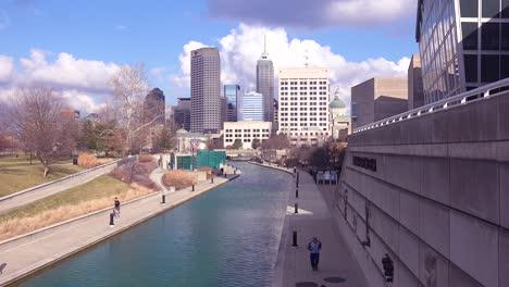 Establishing-shot-of-downtown-city-skyline-and-riverfront-walk-Indianapolis-Indiana-1