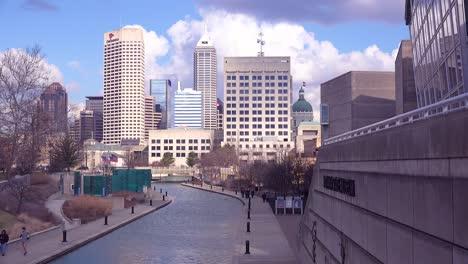 Establishing-shot-of-downtown-city-skyline-and-riverfront-walk-Indianapolis-Indiana-2