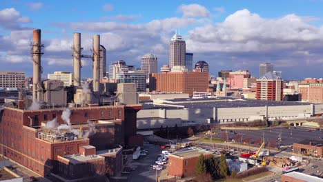 Nice-drone-aerial-of-downtown-Indianapolis-Indiana-with-industrial-factory-in-foreground