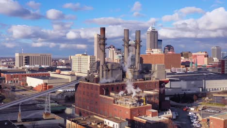 Nice-drone-aerial-of-downtown-Indianapolis-Indiana-with-industrial-factory-in-foreground-1