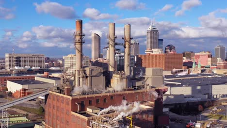 Nice-drone-aerial-of-downtown-Indianapolis-Indiana-with-industrial-factory-in-foreground-2
