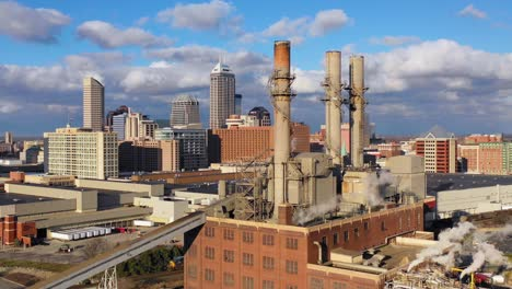 Nice-drone-aerial-of-downtown-Indianapolis-Indiana-with-industrial-factory-in-foreground-3