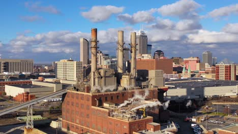 Nice-drone-aerial-of-downtown-Indianapolis-Indiana-with-industrial-factory-in-foreground-4