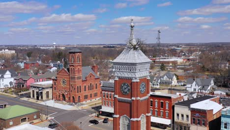 Aerial-of-a-tree-growing-out-of-the-top-of-a-county-courthouse-in-Greensburg-Indiana-1