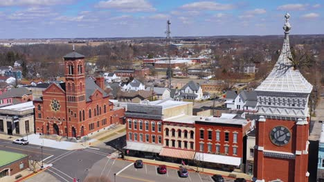 Aerial-of-a-tree-growing-out-of-the-top-of-a-county-courthouse-in-Greensburg-Indiana-2
