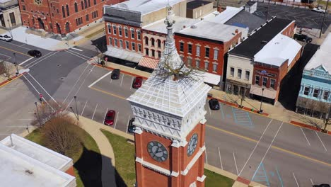 Aerial-of-a-tree-growing-out-of-the-top-of-a-county-courthouse-in-Greensburg-Indiana-3
