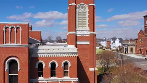 Aerial-of-a-tree-growing-out-of-the-top-of-a-county-courthouse-in-Greensburg-Indiana-5