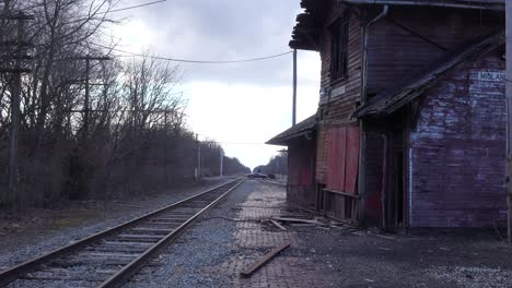 An-old-abandoned-railways-station-platform-and-empty-rail-line-railroad-track-in-distance-suggests-lonely-places