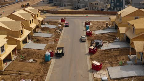 Good-aerial-over-a-neighborhood-of-homes-under-construction-in-the-suburbs-1