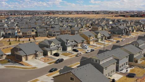 Good-aerial-over-a-neighborhood-of-identical-homes-under-construction-in-the-suburbs-1