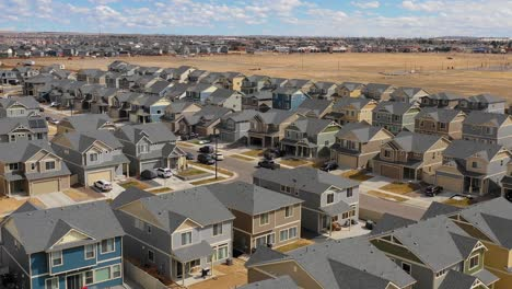 Good-aerial-over-a-neighborhood-of-identical-homes-under-construction-in-the-suburbs-2