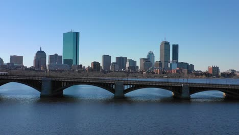 Aerial-establishing-city-skyline-of-Boston-Massachusetts-with-Longfellow-bridge-and-subway-train-crossing